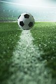 stock photo of flood-lights  - Soccer field with soccer ball and line - JPG