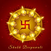 Illuminated oil lit lamps with swastik symbol on red background for occasion of Indian festival of l