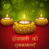 Beautiful greeting card on occasion of Indian festival of lights, decorated with illuminated oil lit
