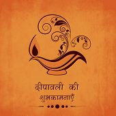 picture of diwali lamp  - Traditional oil lit lamp on floral decorated grungy orange background with Hindi text  - JPG