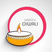 Elegant Happy Diwali greeting card or background with illuminated colorful oil lit lamp on abstract grey and pink background.