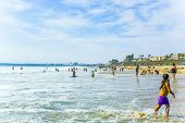 People Enjoy The Beach