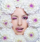 Beauty Girl With White Flowers Around Her Face