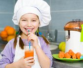 smily girl drink a fresh carrot juice