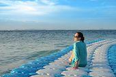 Girl sitting on the dock