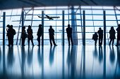 stock photo of leaving  - Travelers silhouettes at airport - JPG