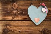 wooden grey heart with edelweiss