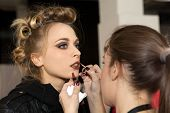 ZAGREB, CROATIA - OCTOBER 17: Fashion model prepares in backstage for Couture show by Marina Design
