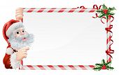 stock photo of peep  - Christmas Santa Claus Sign illustration with Santa peeping round a sign decorated with Christmas Holly sprigs - JPG