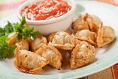 Fried asian wonton noodles with hot sauce