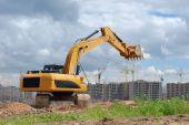 Excavator Against Microdistrict Under Constracion