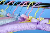 Beautiful hangers on blue background