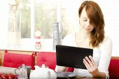 Pretty Young Woman Browsing Her Tablet-pc