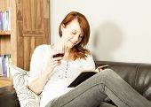 Pretty Young Redhead Woman Reading A Book