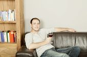 Handsome Happy Man Relaxing With A Glass Of Wine