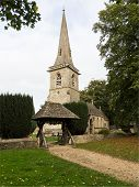 stock photo of church-of-england  - Parish Church in Lower Slaughter in Cotswold or Cotswolds district of southern England in the autumn - JPG