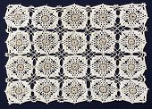 picture of doilies  - Handmade doily on blue background - JPG