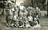 PLOSAJ, POLAND, CIRCA 1950's -  vintage photo of group of little girls and tutors posing together during a summer camp