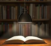 One Book on wooden table under lamp