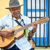 HAVANA, CUBA -?? FEBRUARY 25, 2014: Street musician playing traditional cuban music on an acoustic g