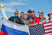 SOCHI, RUSSIA - FEBRUARY 12, 2014: Russian and American fans with flags in the Olympic Park during X
