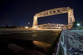 Lift bridge in Duluth Minnesota at night. Ice on the water, wintertime
