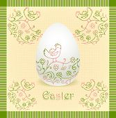 Easter egg with hand drawing beige green color