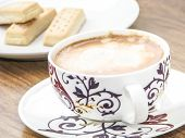 pic of shortbread  - Decorative coffee cup and shortbread biscuits in background - JPG