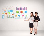 Business woman with colorful graphs and charts concepts