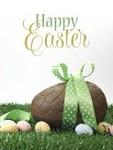 Beautiful Happy Easter Large Chocolate Easter Egg And Small Candy Speckled Eggs On Grass With Sample