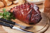 image of roasted pork  - Roasted pork knuckle served on wooden board - JPG