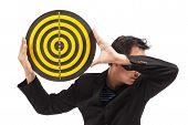 Businessman Holding Target