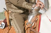foto of vaquero  - Close up of the silver boss on an ornate hispanic saddle - JPG