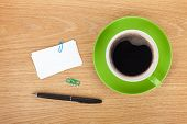 Blank business cards over office table with coffee cup and supplies
