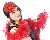 Close-up of a beautiful young flapper dressed in black and red, and wrapped in a feathery boa.   On