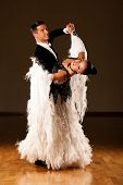 image of waltzing  - Professional ballroom dance couple preform an romantic exhibition dance - JPG