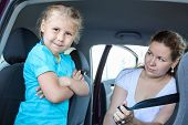 Resentful Child Ignoring Mother Forcing To Seat Into Infant Car Safety Seat