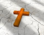 stock photo of christian cross  - wooden christian cross lying on the cracks - JPG