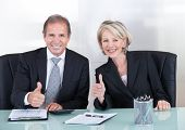 Businesspeople Showing Thump Up Sign