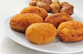 closeup of a plate with croquetas, spanish croquettes