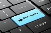 Social network concept: Thumb Up and Community on computer keyboard background