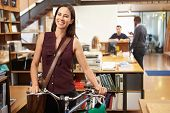 pic of commutator  - Architect Arrives At Work On Bike Pushing It Through Office - JPG