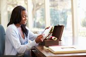 picture of keepsake  - Woman Looking At Letter In Keepsake Box On Desk - JPG