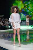 ZAGREB, CROATIA - MARCH 28, 2014: Fashion model wearing clothes designed by Marina Design and Marija Ivanovic bracelets on the 'Fashion.hr' fashion show
