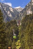 tourists ride the cable car
