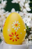 Yellow easter egg with white and red spots