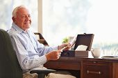 stock photo of keepsake  - Senior Man Putting Letter Into Keepsake Box - JPG