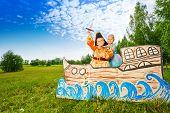 image of pirate sword  - Boy as pirate with sword and princess girl stand on ship made of carton - JPG
