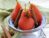 pears cooked in wine with spices (cinnamon and anise)