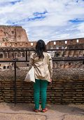 Girl On Excursions At The Colosseum. Rome, Italy